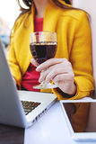 Woman with red wine tablet and laptop in street cafe Stock Image