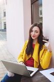 Woman with red wine tablet and laptop in street cafe Royalty Free Stock Photography