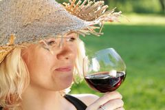 Woman red wine tasting stock photos