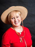 Woman in Red with Woven Hat Royalty Free Stock Image