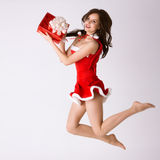 Woman in red xmas costume fly with gift Royalty Free Stock Photo