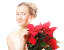 Woman with red xmas flowers Royalty Free Stock Photo