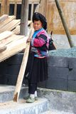 Woman of the Red Yao hill tribe is working in a sawmill, China Royalty Free Stock Photography