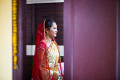 Woman in Red and Yellow Saree Standing Smiling Stock Photography
