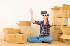 Woman redecoration with VR headset Stock Photos