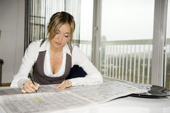 Woman reding newspaper Stock Photo