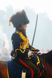 A woman reenactor rides a horse Stock Photography