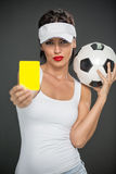 Woman  referee with yellow card Royalty Free Stock Images