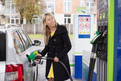 Woman refilling car with fuel Stock Photo