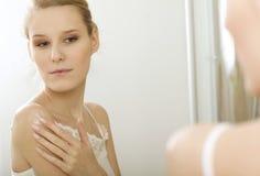 Woman reflaction in mirror Stock Photo