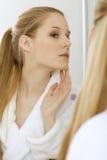 Woman reflaction in mirror Stock Photos