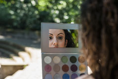 Woman is reflected in the make-up set Royalty Free Stock Photo