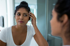 Woman reflecting on mirror. In bathroom at home royalty free stock photo