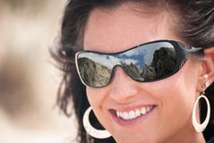 Woman with Reflecting Sunglasses Royalty Free Stock Images