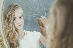 Woman reflection in broken mirror Royalty Free Stock Photography