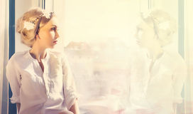 Woman with reflection in window Royalty Free Stock Photos