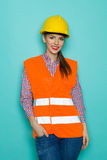 Woman In Reflective Clothing And Yellow Hardhat Royalty Free Stock Photography