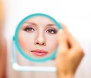 Woman reflexion in mirror Stock Photos