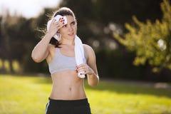 Woman refreshing atfer running Stock Image