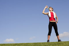 Woman refreshing after the exercise royalty free stock image