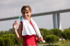 Woman refreshing after the exercise Royalty Free Stock Images