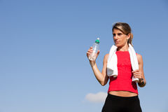 Woman refreshing after the exercise Stock Photos