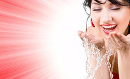 Woman refreshing the face Stock Images