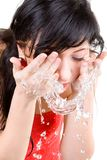 Woman refreshing the face Stock Photography