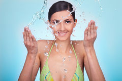 Woman refreshing her face Stock Photography