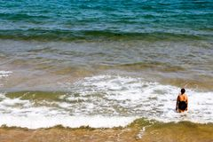 A woman refreshing herself in the sea shore royalty free stock photography