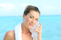 Woman refreshing herslef with water after a work out Stock Photography