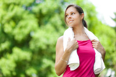 Woman refreshing after running at the city park Stock Photo