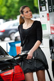 Woman refuel car Stock Images