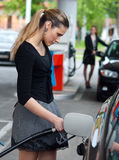 Woman refuel her car Stock Photo