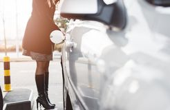 Woman refueling car with diesel Stock Photo