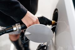 Woman refueling car with diesel Royalty Free Stock Images
