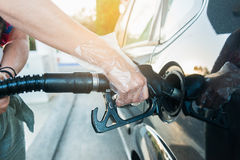 Woman refueling car at the gas station Stock Images