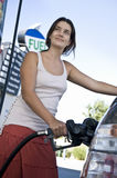 Woman Refueling Car At Natural Gas Station Stock Image