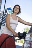 Woman Refueling Car At Natural Gas Station Stock Image