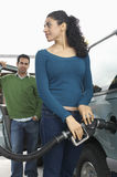 Woman Refueling Car Tank Stock Images