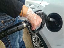 woman refueling the gasoline car tank royalty free stock images