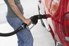 Woman Refueling Her Car Royalty Free Stock Images