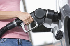 Woman Refueling Her Car At A Fuel Station Royalty Free Stock Photos