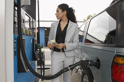 Woman Refuelling Car At Petrol Pump Royalty Free Stock Photo