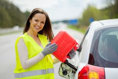 Woman refuelling her car Stock Photography