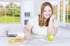 Woman refuses hamburger and french fries Stock Photos