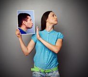 Woman refuses kissing men Stock Images