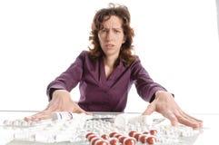 Woman refuses medication Royalty Free Stock Image