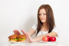 Woman refuses to the junk food Royalty Free Stock Photography