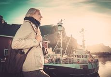 Woman in Reine village, Norway Stock Image